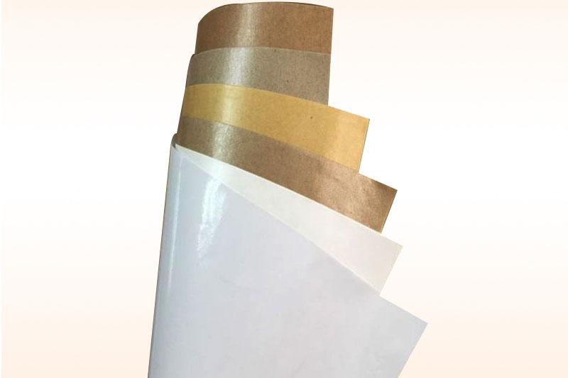 Giấy cuộn trắng và vàng - pe. giấy kraft tráng